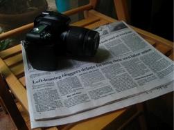 Camera & Newspaper Article
